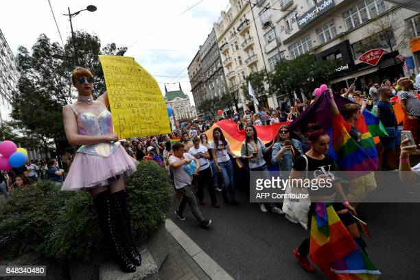 People carry signs and rainbow flags during the Gay Pride parade on September 17, 2017 in Belgrade. Serbia's lesbian prime minister on September 17...