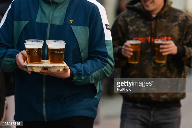 People carry takeaway pints in Dublin city center, during the COVID-19 lockdown. On Saturday, 17 April 2021, in Dublin, Ireland.