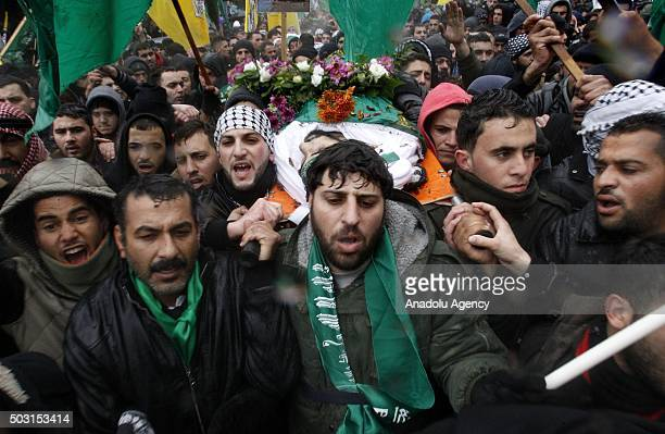 People carry the bodies of 14 Palestinians who have been killed by Israeli soldiers and recently returned back to Palestinian authorities during the...