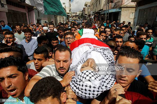People carry the body of 17yearold Palestinian Mohammad Abu Hashsash who was killed by Israeli soldiers at AlFawwar refugee camp during a funeral...