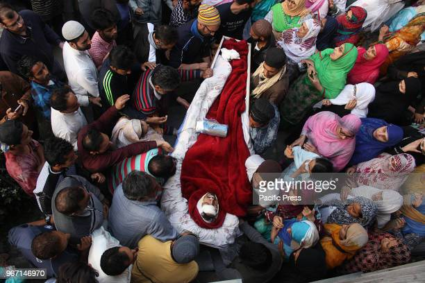 People carry the body of 23 yr old orphan and lone brother of two sisters Qaiser Amin Bhat who succumbed to his injuries after Indian paramilitary...