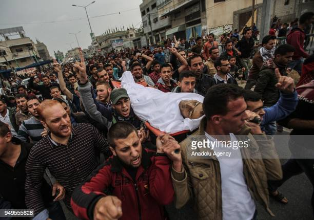 People carry the body of 29yearold Saad Abdul Majid AbdulAal Abu Taha who shot dead by Israel forces during border rallies in Gaza on April 21 2018...