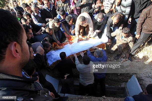 People carry the body of Anwar Abu Zeid a police captain who shot dead two US instructors a South African and two fellow Jordanians at a police...