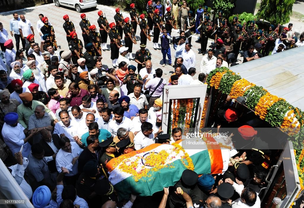 People carry the body of deceased Balram Das Tandon Governor of Chhattisgarh during his funeral rites at Punjab BJP office in Sector 37 before the...