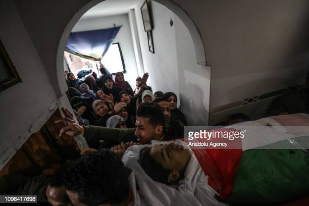 People carry the body of Hassan Shalabi during his funeral ceremony at Nusseirat refugee camp in Gaza February 9 2019 Shalabi was killed after...