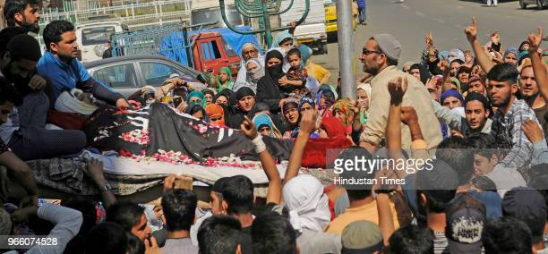 People carry the body of Kaiser Amin Bhat during his funeral procession in downtown on June 2 2018 in Srinagar India Clashes erupted between...