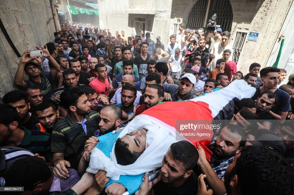 People carry the body of Mohammed Jamal Abu Halima (22) during his funeral ceremony at Shujaiyya neighbourhood of Gaza City, Gaza on July 7, 2018. Abu Halima was killed after Israeli forces intervened in a protest within the 'Great March of Return' demonstrations near Israel-Gaza border.