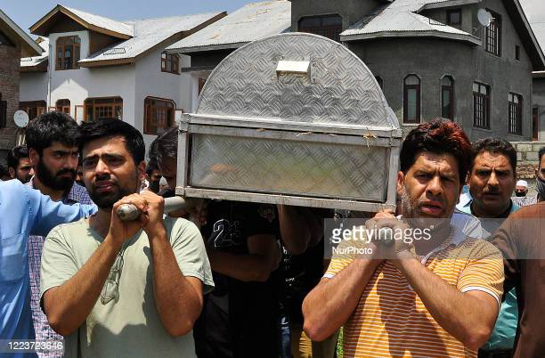 People carry the coffin containing the dead body of a civilian Bashir Ahmad in HMT Srinagar Kashmir on July 01 2020One Indian soldier and a civilian...