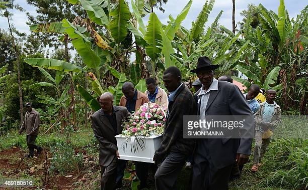 People carry the coffin of Anjela Nyokabi who was killed during the attack on Garissa University during her funerals in her home village of Kiambu on...