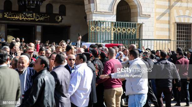 People carry the coffin of Egyptian actress and singer Shadia during the funeral ceremony at the Sayyida Nafisa mosque in Cairo Egypt on November 29...