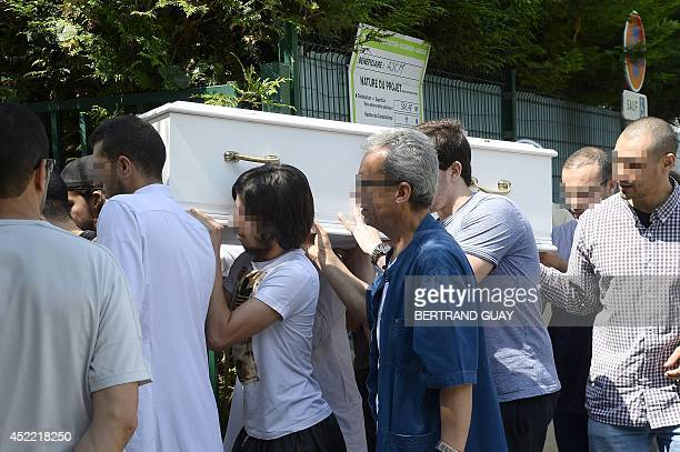 People carry the coffin of eight-year-old Abdelrazak who died last week following a stomach pain at a summer camp in the Ariege region, in front...