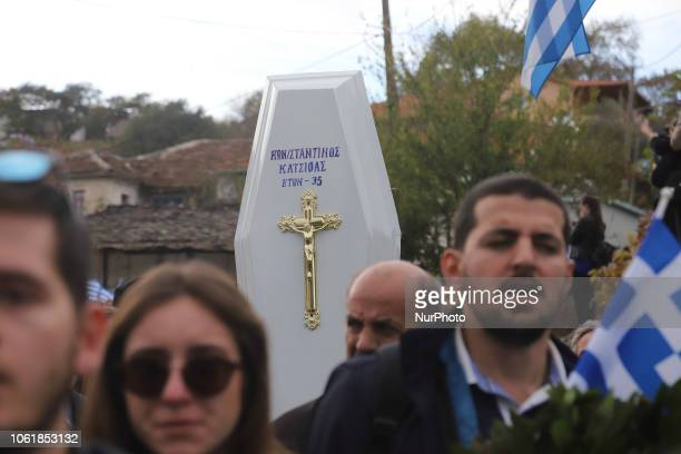 People carry the coffin of Konstantinos Katsifas an ethnic Greek killed during a shootout with Albanian police during his funeral ceremony in the...