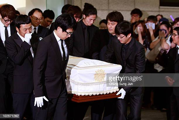 People carry the coffin of late South Korean actor and singer Park YongHa for the funeral at the hospital on July 2 2010 in Seoul South Korea The...