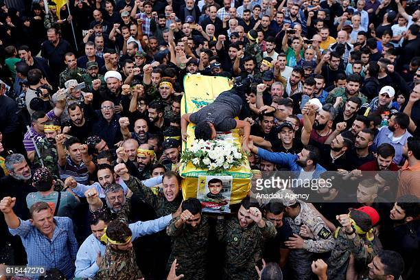 People carry the coffin of member of Hezbollah Hatem Hamadi during a funeral ceremony at Dahieh district of Beirut in Lebanon on October 18 2016