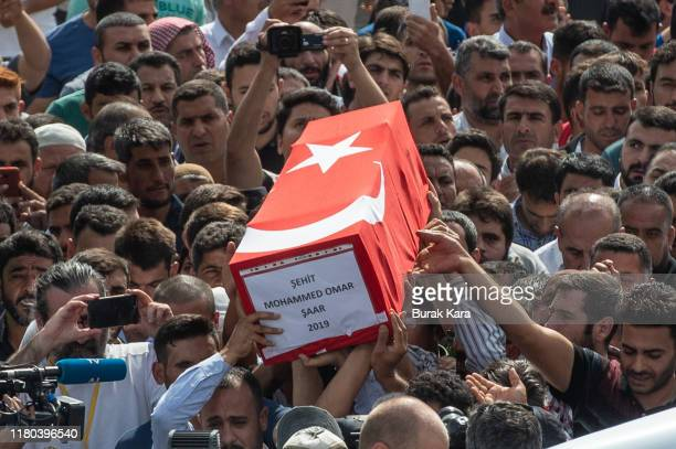 People carry the coffin of Muhammed Omar Saar 9 months old Syrian refugee baby who was killed by mortar yesterday in Akcakale center on October 11...