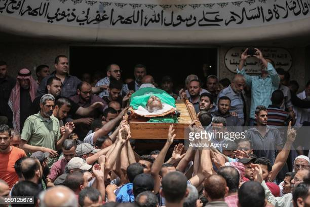 People carry the coffin of Nasir Ahmed Garrab who lost his life after Israeli soldiers opened fire on protest held to mark 70th anniversary of Nakba...