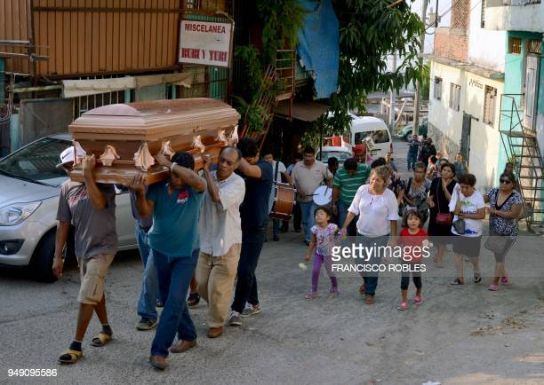 People carry the coffin of one of the six policemen murdered last Tuesday in Coacuyul community in Zihuatanejo during the religious funeral in...