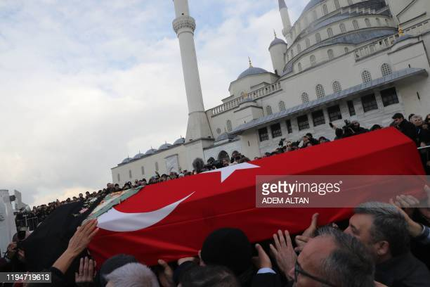 People carry the coffin of Rahsan Ecevit, wife of late Turkish Prime Minister Bulent Ecevit, during her funeral ceremony at the Kocatepe Mosque in...