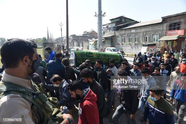 People carry the coffin of slain policeman Altaf Ahmad during his funeral procession at Eidgah on October 7 2020 in Srinagar India Militants attacked...