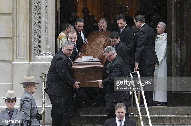 People carry the coffin of the former New York Governor Mario Cuomo who died in New Years Day at the age of 82 during the funeral service in New York...