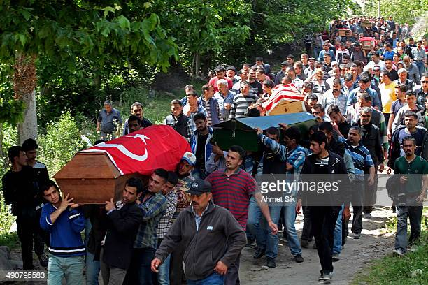 People carry the coffins of the miners to the cemetery after a mining disaster on May 15, 2014 in Soma, a district in Turkey's western province of...