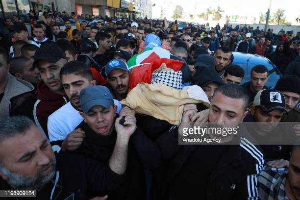 People carry the dead body of 19yearold Yazan Abu Tabikh who succumbed to his wounds at Doctor Khalil Suleiman Hospital after being shot by Israeli...