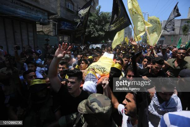 People carry the dead body of a 25yearold Palestinian Ahmed Yahya Yagi who was killed after Israeli army gunfire on the 'Great March of Return'...