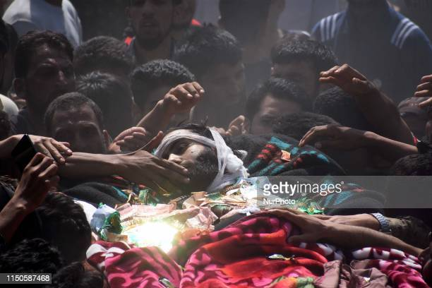 People carry the dead body of a local militant Tawseef Ahmad during his funeral in Marhama area of Bijbehara some 45 kilometers from SrinagarKashmir...