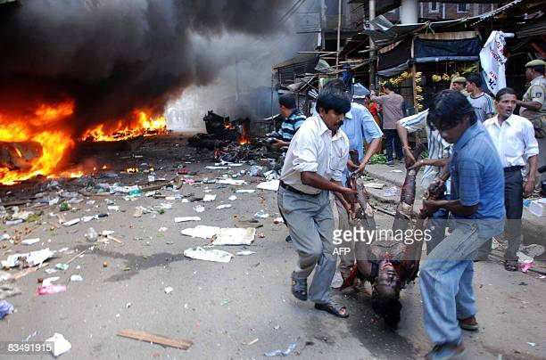 People carry the dead body of a woman from the blast site at the Ganeshguri area in Guwahati the capital city of India�s northeastern state of Assam...