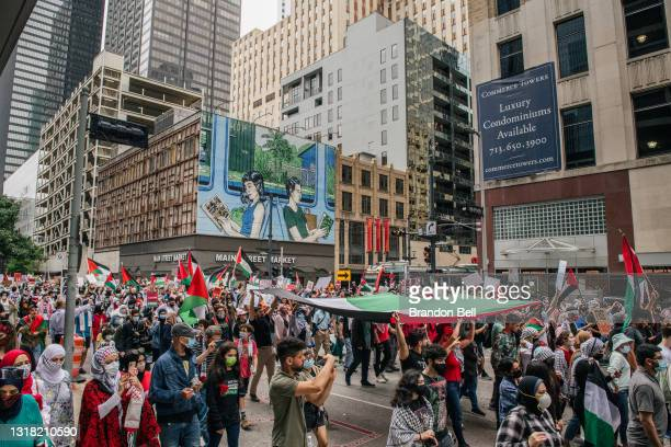 People carry the Palestinian flag during a march to the Houston City Hall on May 15, 2021 in Houston, Texas. People gathered during a rally to show...