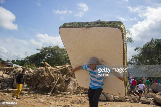 People carry their belongings in a zone affected by the landslide in Mocoa Colombia 04 April 2017