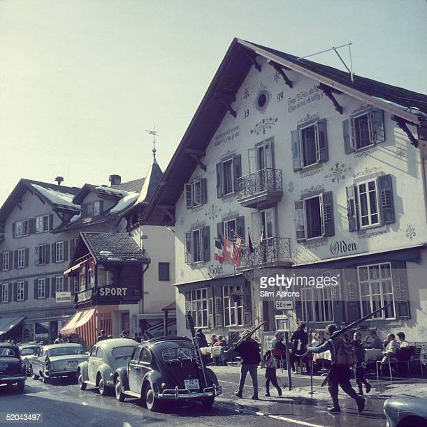 People carry their skis past the Hotel Olden in Gstaad 1961