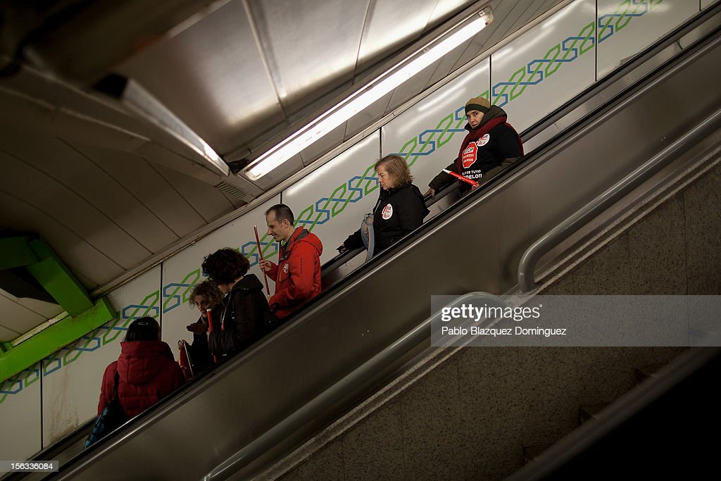 People carry Trade Unions flags while entering a tube station on November 13, 2012 in Madrid, Spain. Spain's trade unions have called a general strike for November 14, the second general strike during Mariano Rajoy's presidency. Protestors from social movements are expected to join striking public sector workers to protest against austerity cuts and labour reforms. Spain's unemployment rate has now reached 25 per cent.