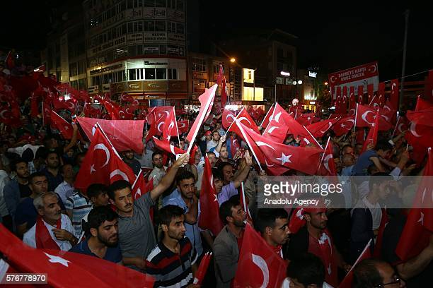 People carry Turkish flags at Besyol Square in Van Turkey on July 17 2016 as they gather to protest the 'Parallel State/Gulenist Terrorist...