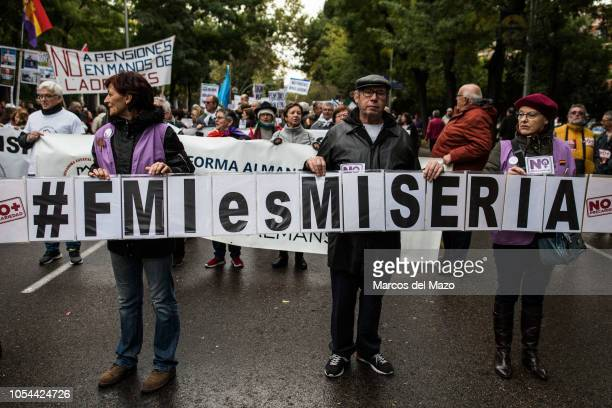 People carrying a banner that reads International Monetary Fund is misery during a demonstration under the slogan If we move we change everything...