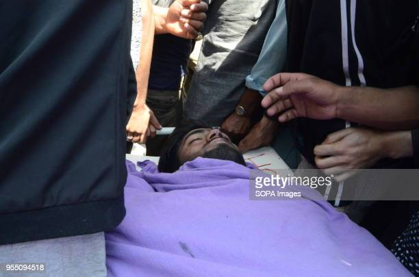 CHATABAL SRINAGAR JAMMU KASHMIR INDIA People carrying body of civilian Adil Ahmed Yatoo who died after hitting the armour vehicle during clashes...