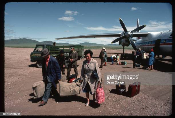 People Carrying Luggage From Plane Mongolia