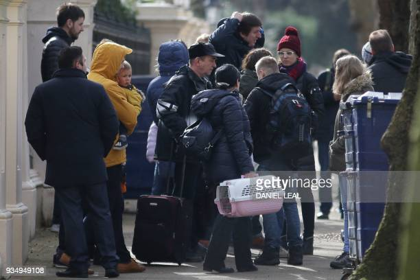 TOPSHOT People carrying luggage leave the Russian Embassy in London on March 20 2018 and board a van bearing diplomatic plates Dozens of people...