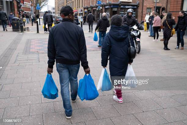 People carrying plastic carrier bags of shopping on 14th March 2020 in Birmingham, United Kingdom. In recent years following global concerns over...