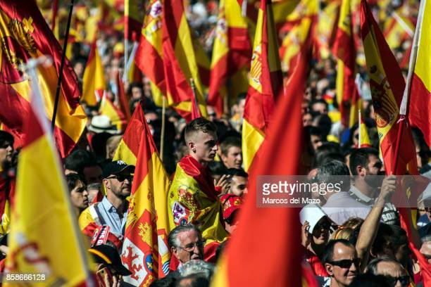 People carrying Spanish flags during a demonstration demanding the unity of Spain and against the independence of Catalonia