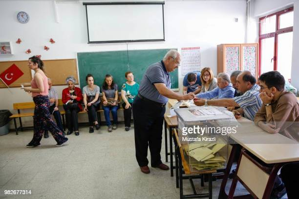 People cast their ballot at a polling station during a presidential and parliamentary elections on June 24, 2018 in Ankara, Turkey. More than 59...