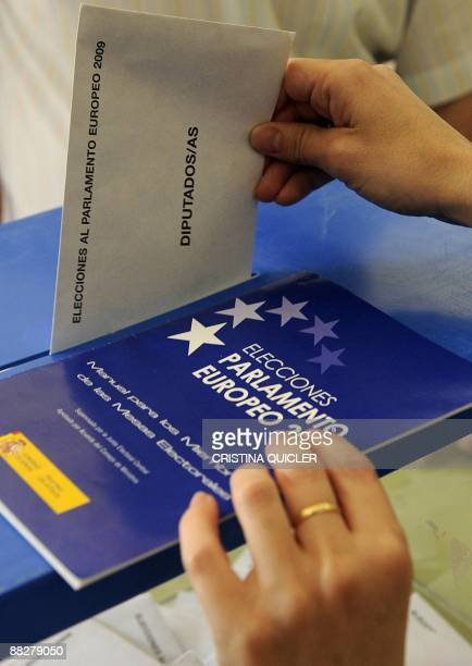 People cast their ballot at a polling station in Umbrete southwestern Spain on June 7 2009 during the European parliamentary election Most EU nations...