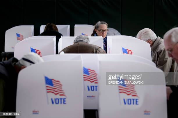 TOPSHOT People cast their ballots at a community center during early voting October 25 2018 in Potomac Maryland two weeks ahead of the key US midterm...
