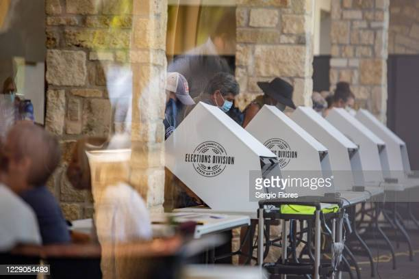 People cast their ballots at a polling location on October 13, 2020 in Austin, Texas. The first day of voting saw voters waiting hours in line to...