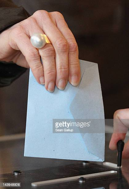 People cast their ballots at a polling station in the Marais district in the second and final round of French presidential elections on May 6 2012 in...
