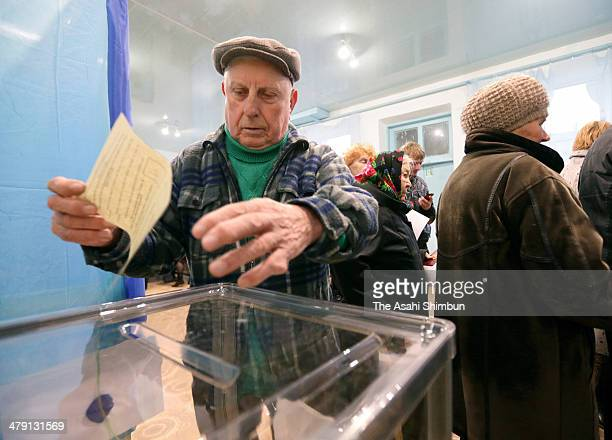 People cast their ballots at a polling station on March 16 2014 in Bakhchysarai Ukraine There are not Crimean tatar people at this polling station...