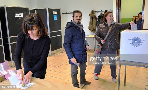 People cast their ballots for the referendum on constitutional reforms at a polling station on December 4 2016 in Rome Italy The result of the...