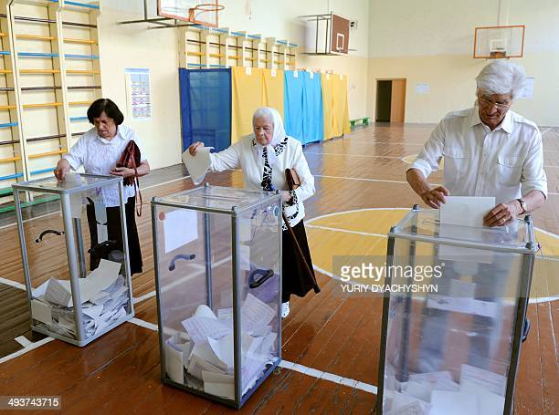 People cast their ballots in a polling station in the western Ukrainian city of Lviv on May 25 2014 Ukraine began voting on Sunday in a presidential...