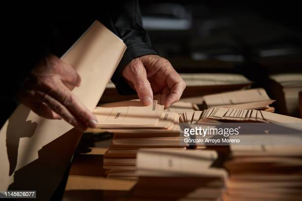 People cast their vote at a polling station for the Spanish general elections in Spain on April 28 2019 at Pinar del Rey school in Madrid Spain...
