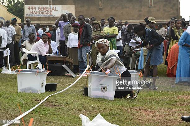 People cast their vote in presidential and parliamentary polls on February 18 2016 at the Nasuti polling station in Mukono District some 23...